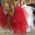 Нарядное платье с бантом и золотом
